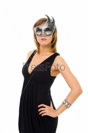 Фотография на тему Молодая женщина в маске на сером фоне
