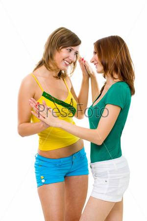 Фотография на тему Две молодые спокойные женщины улыбаются и играют в ладушки