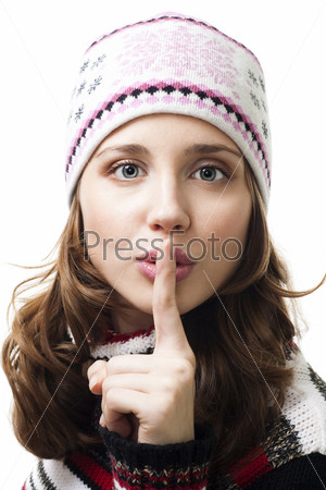 Фотография на тему Красивая женщина в шапке с пальцем у рта  на белом фоне