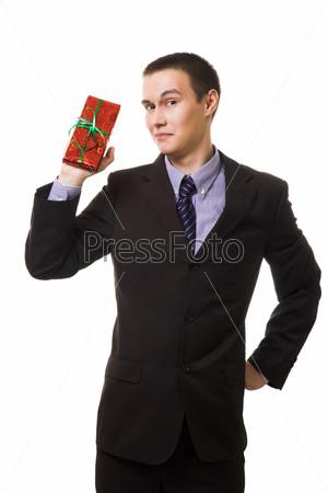 Фотография на тему Молодой человек с подарком в руках