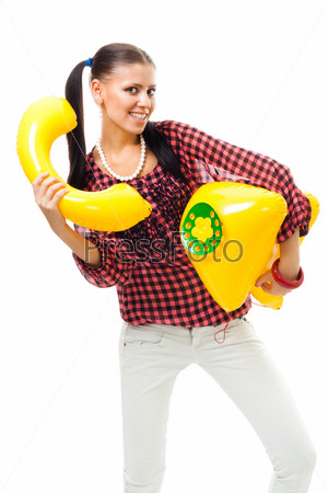 Фотография на тему Счастливая молодая девушка с надувным детским телефоном