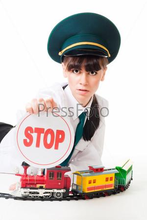 Фотография на тему Девушка играет с детской железной дорогой