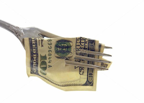 Фотография на тему Купюра достоинством сто долларов на вилке - изолированный объект