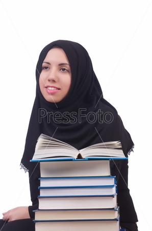 Фотография на тему Молодая студентка-мусульманка с книгами