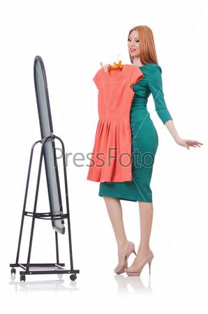 Фотография на тему Женщина меряет новую одежду на белом