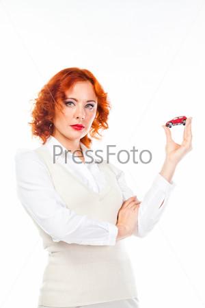 Фотография на тему Молодая и красивая женщина с игрушечной машиной в руках