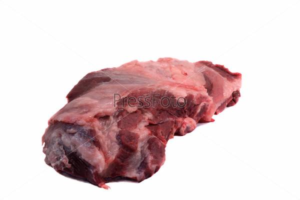 Фотография на тему Большой кусок сырой свинины на белом фоне