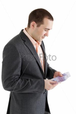 Фотография на тему Пачка банкнот достоинством 500 евро в руках мужчины