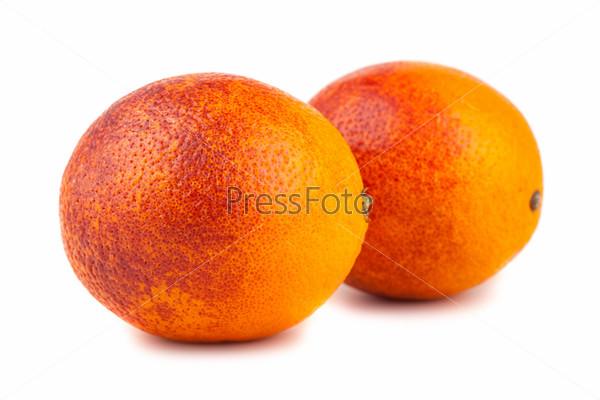 Пара красных апельсинов