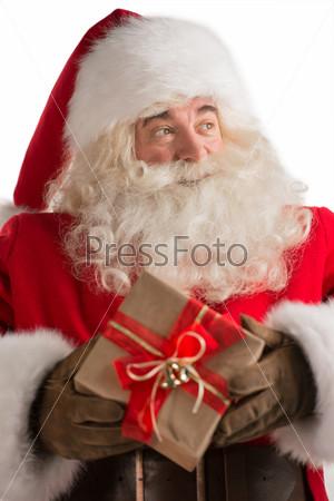 Фотография на тему Портрет доброго Санта-Клаус с рождественским подарком