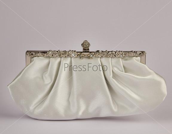 Фотография на тему Женская сумочка, серый фон