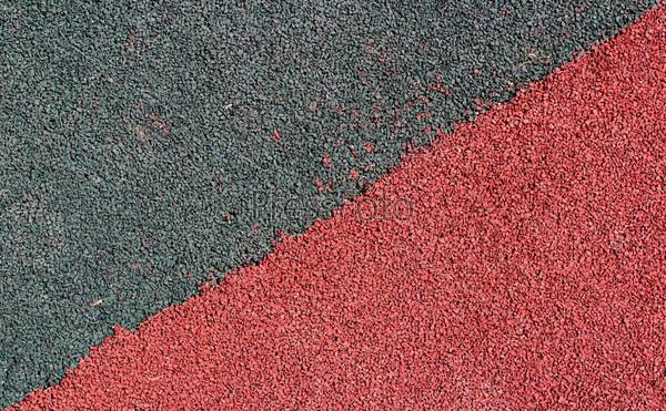Покрытие из резиновой крошки (резиновый асфальт), используется на стадионах для беговой дорожки