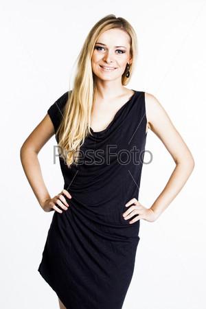 Фотография на тему Красивая и молодая женщина в сером платье
