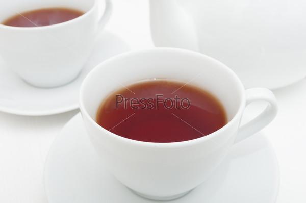 Чашки чая и чайник