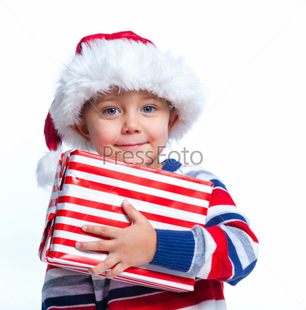 Фотография на тему Маленький мальчик в шапке Санта Клауса с подарком