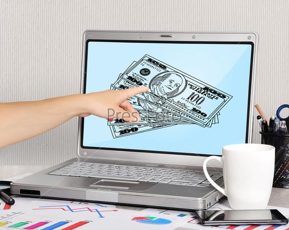 Фотография на тему Ноутбук с долларами