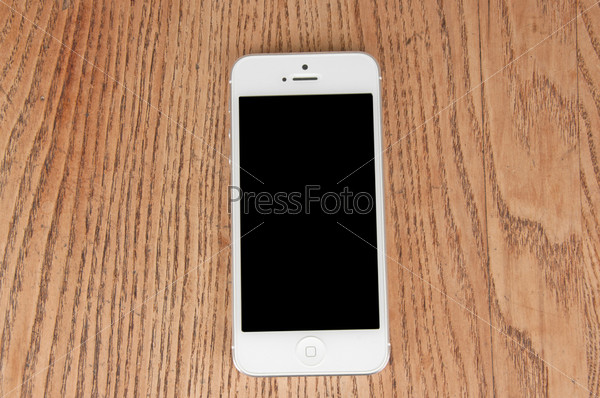 Белый телефон на столе