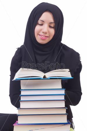 Фотография на тему Молодая студентка мусульманка с книгами