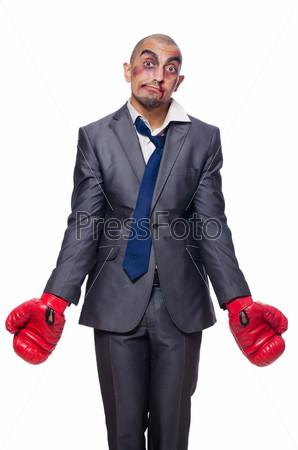 Фотография на тему Сильно избитый бизнесмен с боксерскими перчатками