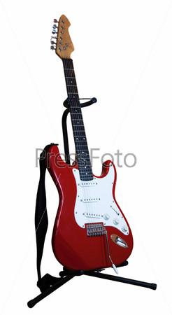 Красная электрическая гитара на подставке