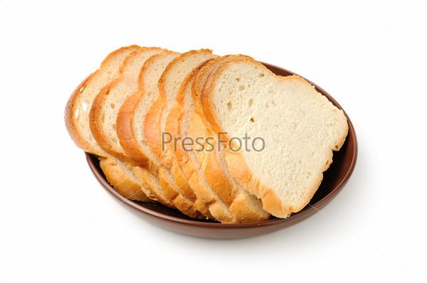 Фотография на тему Резаный хлеб на тарелке