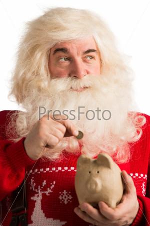 Санта-Клаус кладет золотую монету в копилку