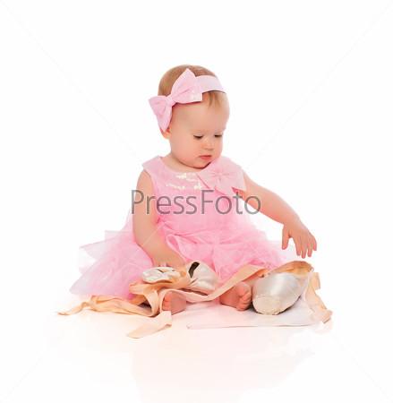 Фотография на тему Маленькая девочка в розовой пачке и пуантах