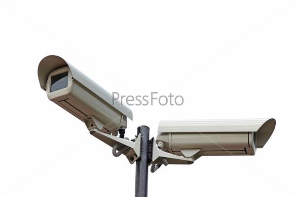 Две камеры видеонаблюдения на белом фоне