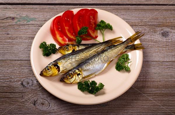 Фотография на тему Копченая рыба в тарелке