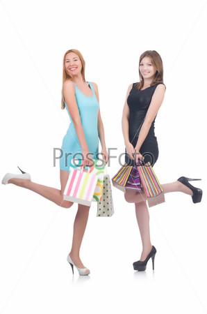 Девушка после шопинга на белом фоне