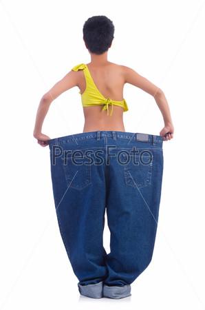 Фотография на тему Женщина с большими джинсами в концепции диеты
