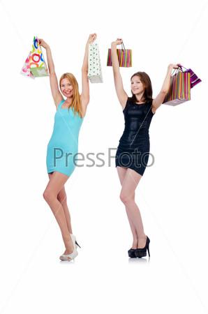 Девушки после шопинга на белом фоне