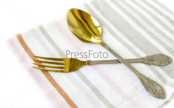 Фотография на тему Ложка и вилка на льняной салфетке