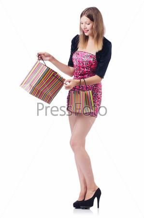 Девушка после хорошего шопинга на белом фоне