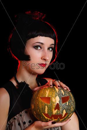 Фотография на тему Женщина с тыквой на Хэллоуин