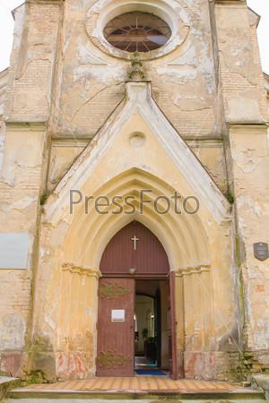 Old opened vintage door in church