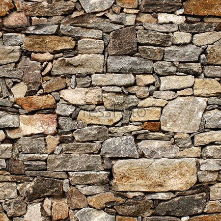 Seamless texture of medieval wall of stone blocks