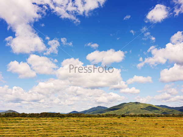 Landscape with mountain views, arable land, blue sky and beautif