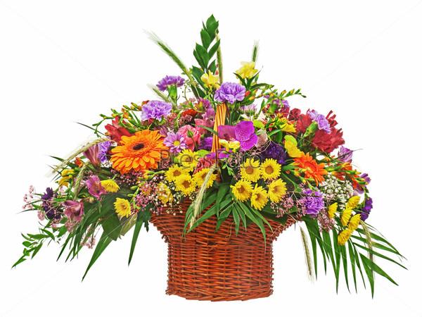 Flower bouquet arrangement centerpiece in wicker basket isolated