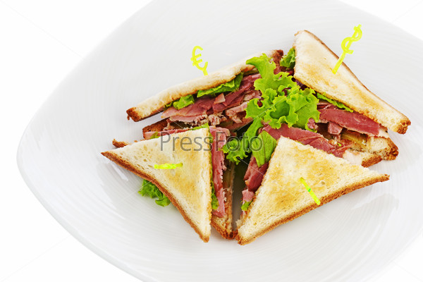 Sandwiches with  chicken, bacon and vegetables isolated on white