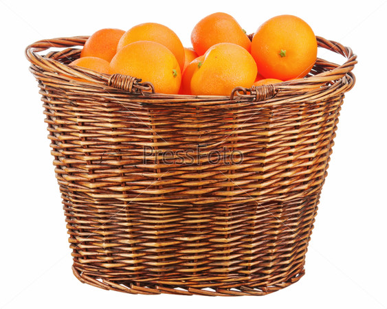 Oranges in wicker basket isolated on white.