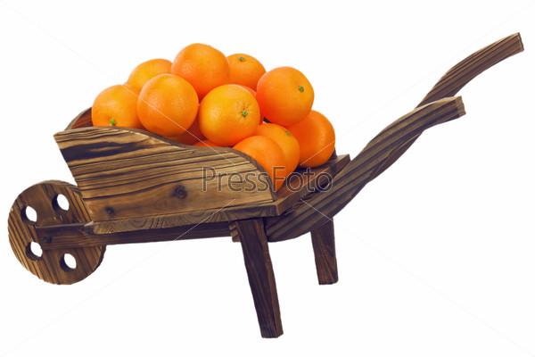 Oranges on pushcart  isolated on white.