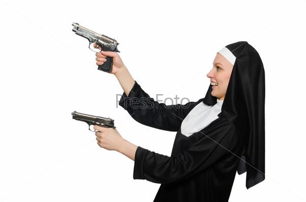 Nun with handgun isolated on white