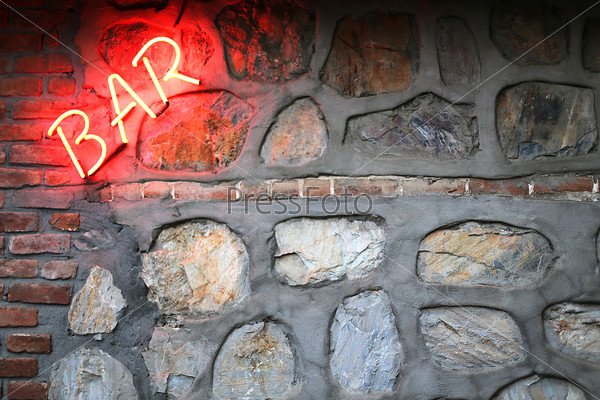 Bar sign on a stone wall