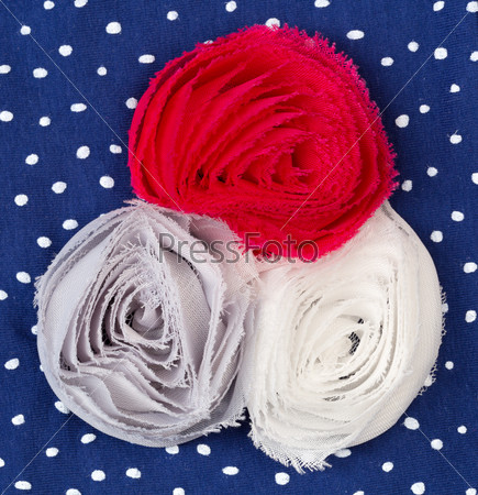 Three colored fabric flower