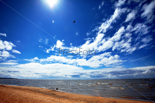 The sky with clouds and a beach.