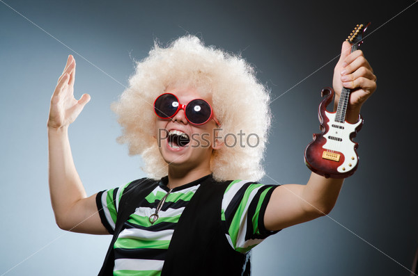 Funny man with miniature guitar