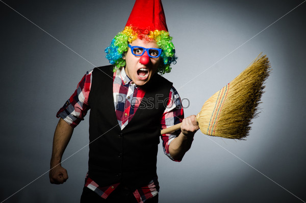 Funny clown with the broom