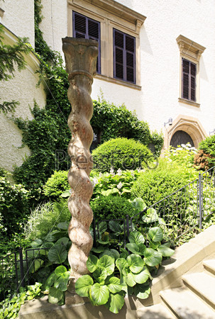Carved wooden pole of castle Konopiste