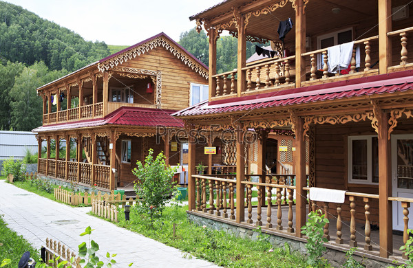 Beautiful wooden cottages in the mountains.